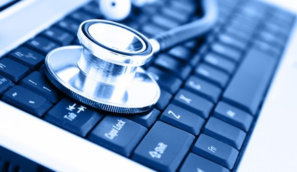 Sthétoscope sur un clavier-Santé au travail
